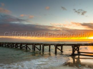 The old Jetty of Strand Beach bathed in sunset colors